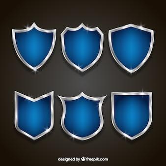 Reeks elegante blauwe en zilveren schilden