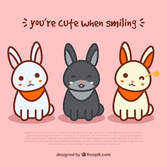 Roze achtergrond met drie gelukkige konijnen