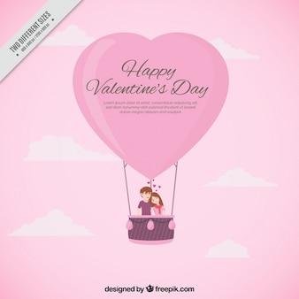 Roze achtergrond van het paar in een hartvormige ballon