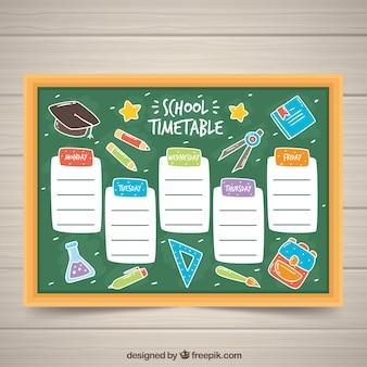 School rooster op het schoolbord met tekeningen