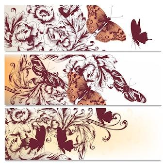 Set van floral banners met de hand getekende vlinders