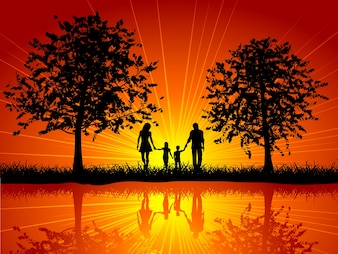Silhouet van een familie die buiten onder bomen loopt