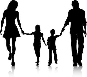 Silhouet van een familie die hand in hand loopt