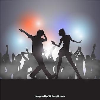 Silhouetten van mensen dansen