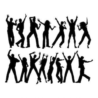 Silhouetten van veel mensen aan het dansen