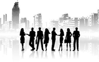 Silhouetten van zakenmensen tegen grunge stad achtergrond