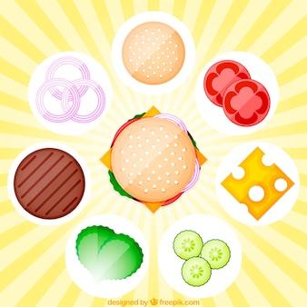 Sunburst achtergrond met hamburger en smakelijke ingrediënten