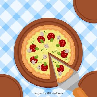 Tafelkleedachtergrond met heerlijke pizza