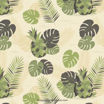 Vintage achtergrond met ananas en bladeren in groene tinten
