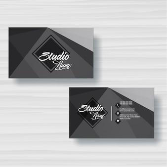 Visitekaartje met geometrische vormen in grijstinten