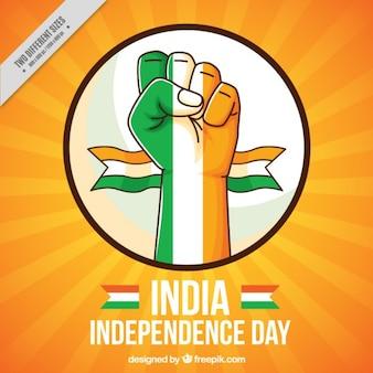 Vuist met de vlag van india achtergrond