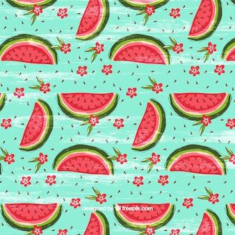 Waterverf patroon met watermeloenen en bloemenachtergrond