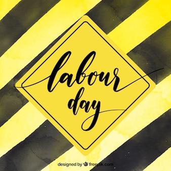 Zwarte en gele achtergrond voor de dag van de arbeid