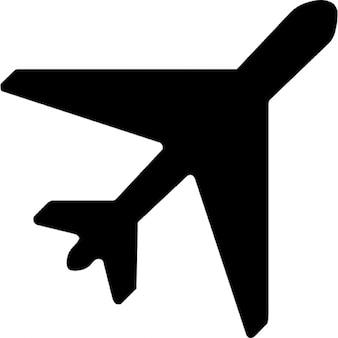 Samolotem ciemny kształt obraca się w prawo po przekątnej