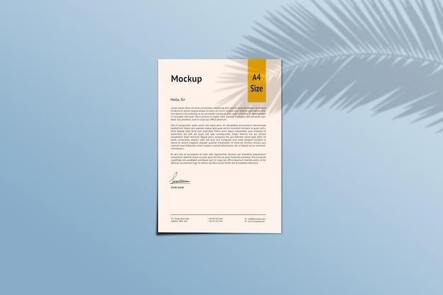 A4 papier makieta renderowania projektu na białym tle z cienia