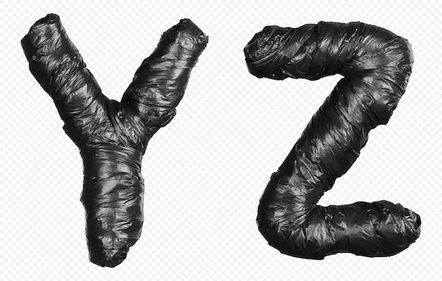 Alfabet czarny worek na śmieci litery y i z na białym tle