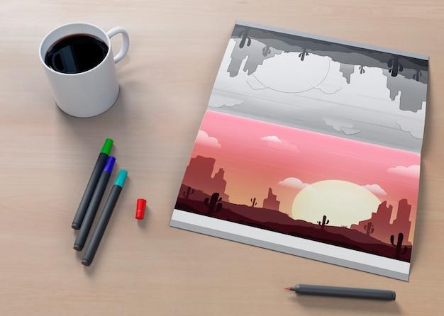 Arkusz z rysunkiem natury i kawą obok