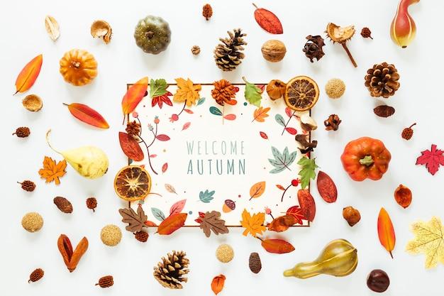 Biała karta makiety otoczona liśćmi