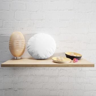 Biała miękka poduszka i lampa na drewnianej półce
