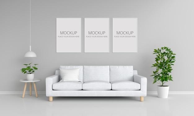 Biała sofa w szarym salonie z makietą ramek