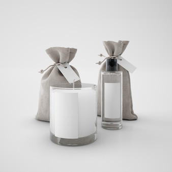 Biała świeca, worki i flakon perfum