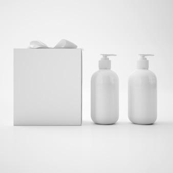 Białe pojemniki na mydło i białe pudełko z kokardą