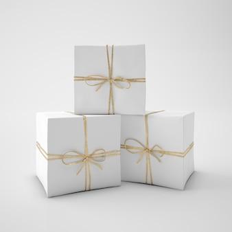 Białe pudełka ze sznurkiem