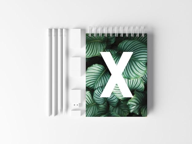 Biały notatnik makieta biurka