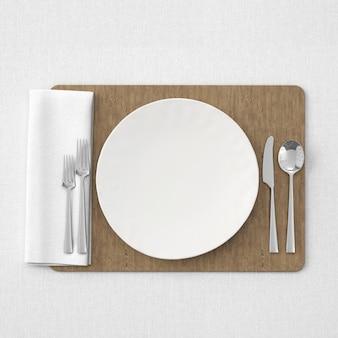 Biały stół na drewnianej macie