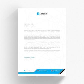 Biały szablon firmowy z niebieskimi kształtami