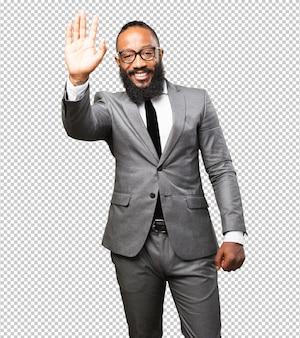 Biznesowy czarny mężczyzna powitania gest