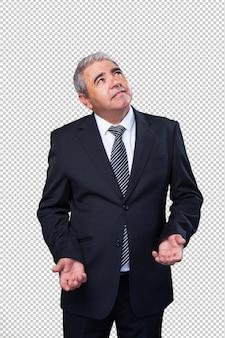 Biznesowy mężczyzna robi wątpliwość gestowi