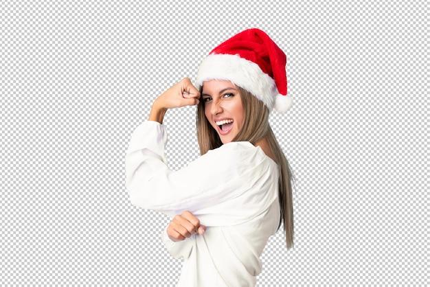 Blondynki dziewczyna z boże narodzenie kapeluszem robi silnemu gestowi