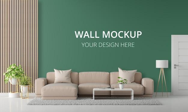 Brązowa sofa w zielonym salonie z makietą ścienną