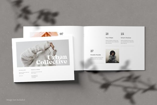Broszura w orientacji poziomej i makieta katalogu widok z góry