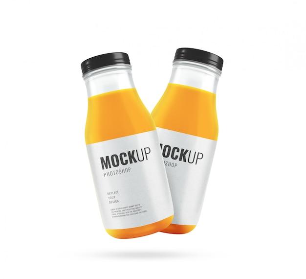 Butelki soku pomarańczowego