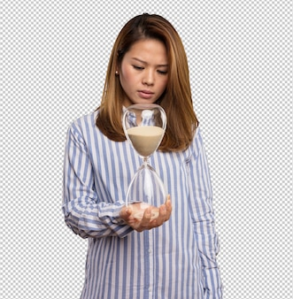 Chińska kobieta trzyma piaska zegar