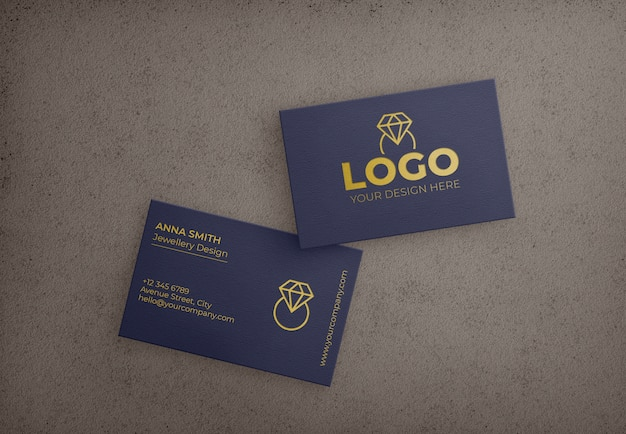Ciemnoniebieska karta biznesowa ze złotym wzorem