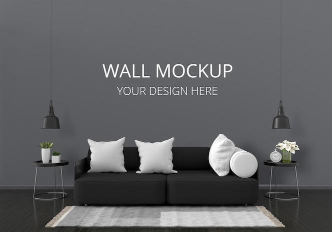 Czarna sofa w salonie z makietą ścienną