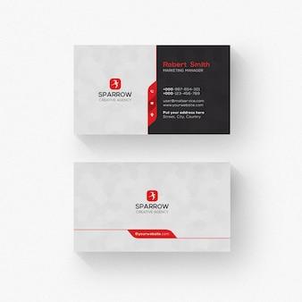 Czarno-biała wizytówka z czerwonymi detalami