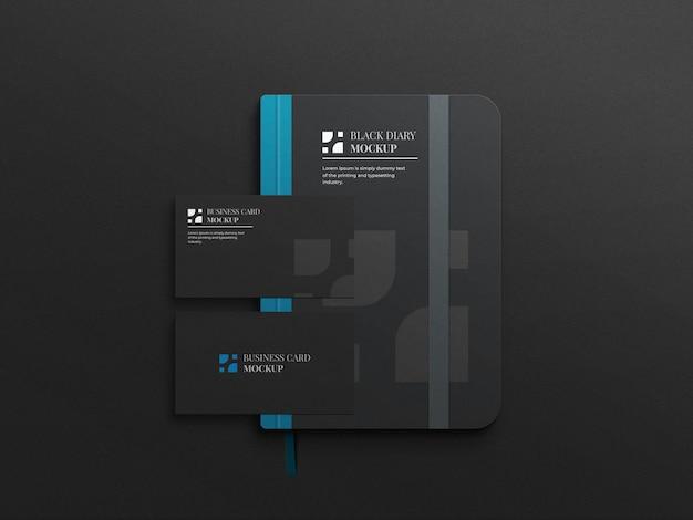 Czarno-niebieska makieta pamiętnika z wizytówką