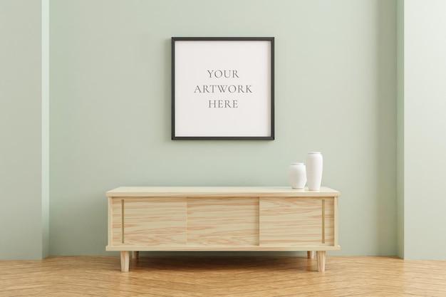Czarny kwadrat plakat rama makieta na drewnianym stole we wnętrzu salonu na tle ściany pusty pastelowy kolor. renderowanie 3d.