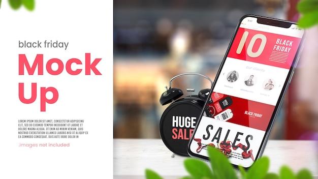 Czarny piątek makieta smartfona z budzikiem na stole sklepowym