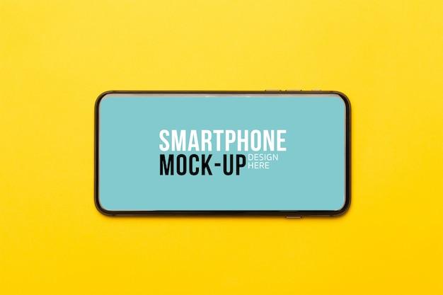 Czarny smartfon z ekranem. szablon makiety