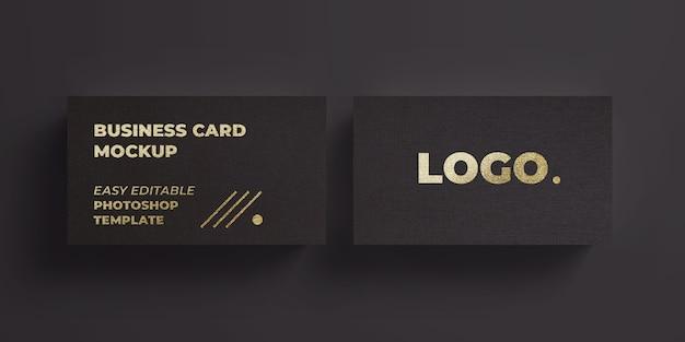 Czarny szablon wizytówki z makietą efektu tekstu złota