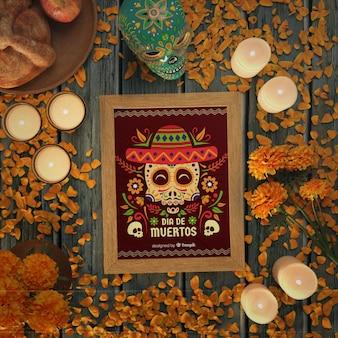 Czerwona makieta dia de muertos otoczona świecami i kwiatami