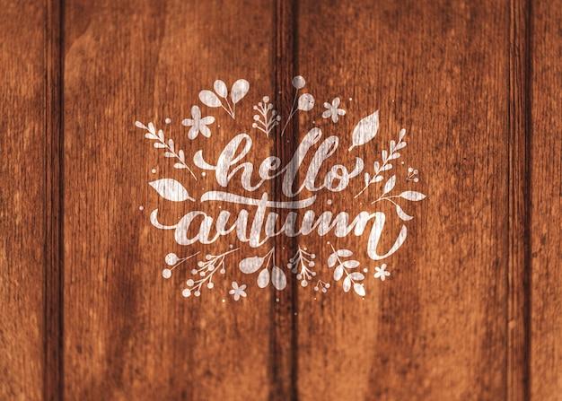 Cześć jesień pisać na drewnianym tle