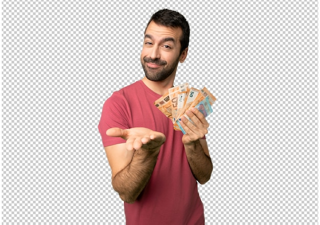 Człowiek biorąc dużo pieniędzy gospodarstwa wyobraźni na dłoni, aby wstawić reklamę