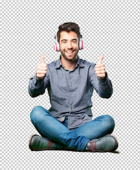 Człowiek siedzi na podłodze, słuchanie muzyki