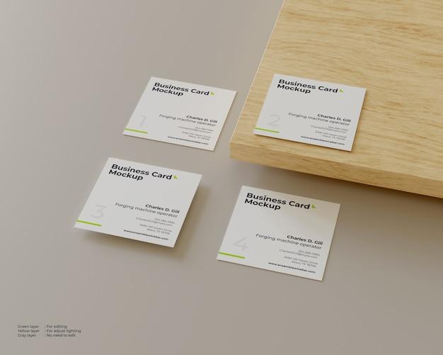 Cztery Makiety Wizytówek, Z Których Jedna Jest Na Drewnie Premium Psd